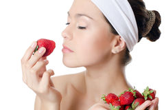 The beautiful woman with a strawberry Royalty Free Stock Images
