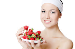 The beautiful woman with strawberry  Royalty Free Stock Photography
