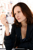 Beautiful woman in street cafe Royalty Free Stock Photos