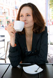 Beautiful woman in street cafe Royalty Free Stock Photography