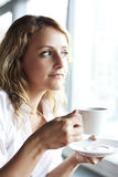 Beautiful woman in street cafe ,with cup Stock Photography