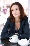 Beautiful woman in street cafe with tea Stock Photo