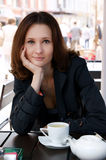 Beautiful woman in street cafe with tea Royalty Free Stock Photography