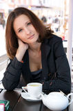 Beautiful woman in street cafe with tea Royalty Free Stock Images