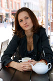 Beautiful woman in street cafe with tea Stock Images
