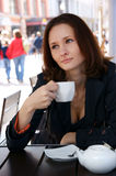 Beautiful woman in street cafe with tea Royalty Free Stock Photos