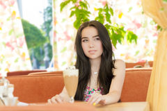Beautiful woman in street cafe Royalty Free Stock Images