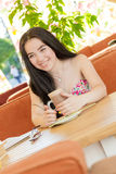 Beautiful woman in street cafe Stock Photography