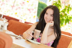 Beautiful woman in street cafe Stock Photos