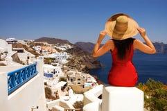 Beautiful woman on the streets of Oia, Santorini. Beautiful young Greek woman on the streets of Oia, Santorini, Greece royalty free stock image