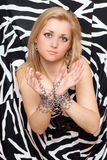 Beautiful woman stretches out her hands in chains Royalty Free Stock Images