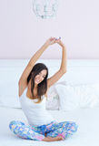 Beautiful woman stretching in bed Royalty Free Stock Photos
