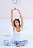 Beautiful woman stretching in bed Royalty Free Stock Image