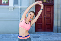 A beautiful woman stretching her arms Stock Photography