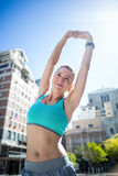 A beautiful woman stretching her arms Royalty Free Stock Photography