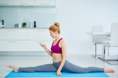 Beautiful Woman Stretching at Home and Listening to Music stock images