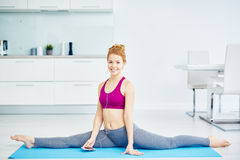 Beautiful Woman Stretching at Home Stock Photography