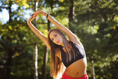 Beautiful woman stretching outdoor Royalty Free Stock Images