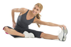 Beautiful Woman Stretching To Touch Her Toes Royalty Free Stock Photography