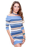 Beautiful woman in a striped dress Stock Photos