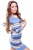 Beautiful woman in a striped dress Royalty Free Stock Photo