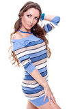 Beautiful woman in a striped dress Stock Images