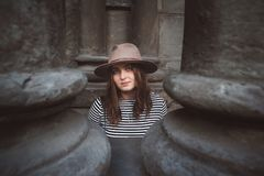 Beautiful woman in a hat and striped shirt looking at the camera. Close-up portrait stock image