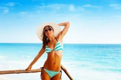 Beautiful woman in stripped bikini and sunglasses Stock Image
