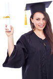 Beautiful woman student in graduation gown holding a diploma Stock Photography