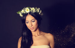 Beautiful woman in studio with golden glitter Stock Photos