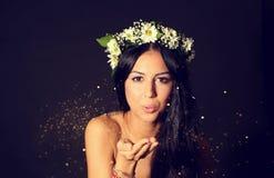 Beautiful woman in studio with golden glitter Stock Photo