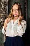 Beautiful woman in  Studio with interior of old palace. Royalty Free Stock Photography