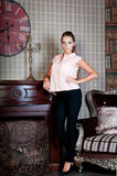 Beautiful woman in studio, luxury style. Beige blouse Royalty Free Stock Image