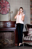 Beautiful woman in studio, luxury style. Beige blouse Stock Images