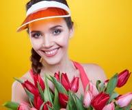 Beautiful woman studio portrait with tulip flowers Royalty Free Stock Photo
