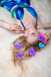 Beautiful woman in the studio with a wreath of flowers on her he Royalty Free Stock Images