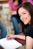 Beautiful woman studying Stock Image
