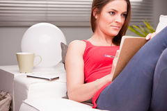 Beautiful woman studying on her couch Royalty Free Stock Photos