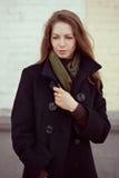 Beautiful woman in a stylish black coat Royalty Free Stock Photos
