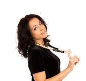 Beautiful woman in a stylish necklace stock photo