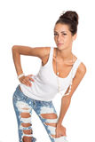 Beautiful  woman in stylish ripped jeans Stock Photography