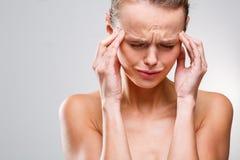 Beautiful woman suffering from acute headache Stock Photos