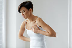 Beautiful Woman Suffering From Pain In Chest. Health Issues Royalty Free Stock Images