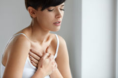 Beautiful Woman Suffering From Pain In Chest. Health Issues Stock Photo