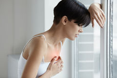 Beautiful Woman Suffering From Pain In Chest. Health Issues Royalty Free Stock Image