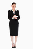 Beautiful woman in suit writing on a notebook Stock Photography