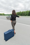 Beautiful woman with suitcase. Back view Royalty Free Stock Photography