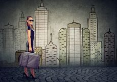 Beautiful woman with suitcase ready to explore the city royalty free stock photos