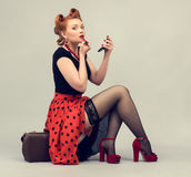 Beautiful woman with a suitcase in a retro style. Royalty Free Stock Images