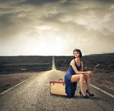 Beautiful woman on a suitcase Royalty Free Stock Photos